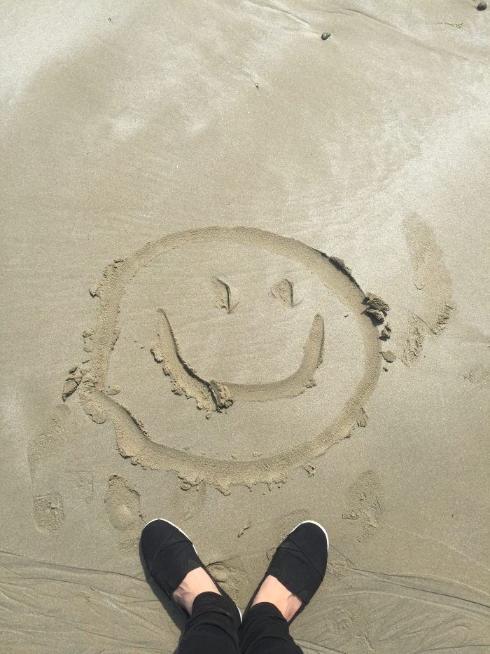 smiley-drawing-on-sand-698899